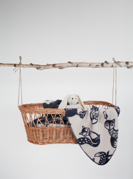 Fox tail blanket in a basket