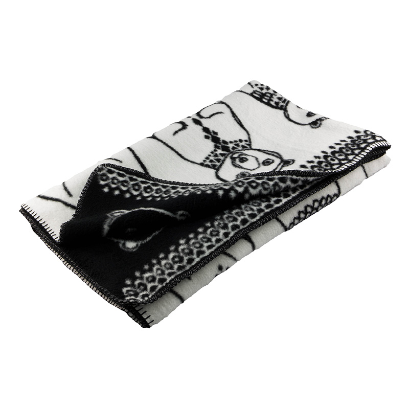 A fun and inspiring luxuriously soft woven organic cotton blanket Greeland Gang black and white