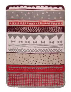 safe, soft and worm brushed cotton blanket for a baby in green, beige and red colors