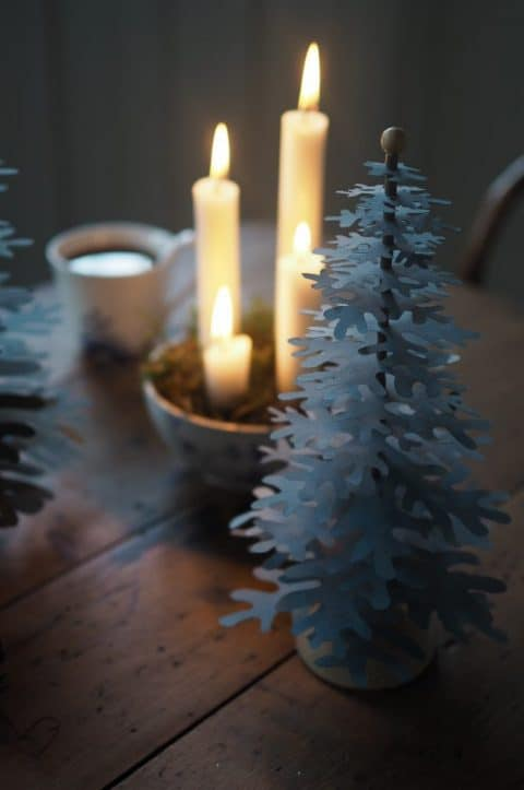 Advent decoration idea with four candles and paper Christmas trees and grey / blue