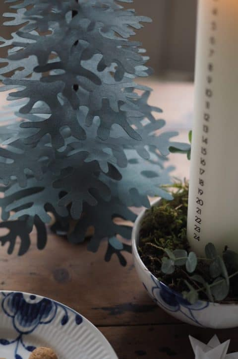 Christmas decoration idea with candle and paper trees