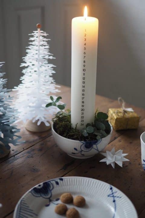 calender lys dekoration med papir juletræer