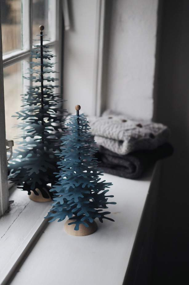 minimalist christmas decor idea for any window sill in scandinavian style with paper trees ornaments from